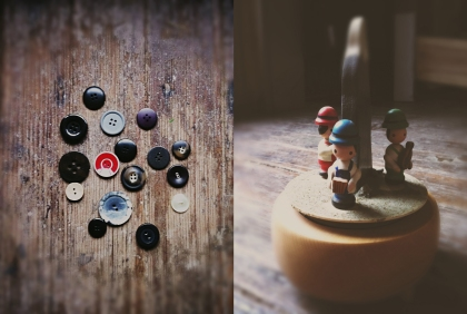 "l. vintage buttons to lost coats. r. music box from my mother that plays ""climb every mountain."""