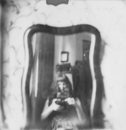 Out of focus: An old mirror that Jeff found in the trash with an old bed sheet for a backdrop.